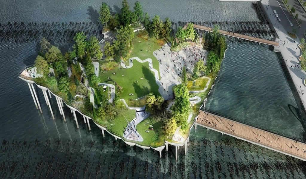 Construyen una plaza con hongos de concreto en el río